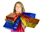 Happy teen girl holding shopping bags — Stock Photo