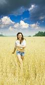 Running girl on field — Stock Photo
