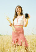 Girl with quass and wheat — Stock Photo