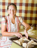Woman making meat pasty — Stock Photo