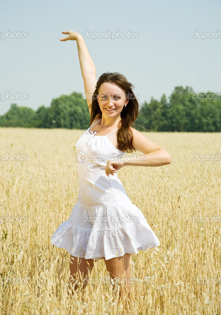 Standing girl  in white at cereals field in summer — Stock Photo #3842057