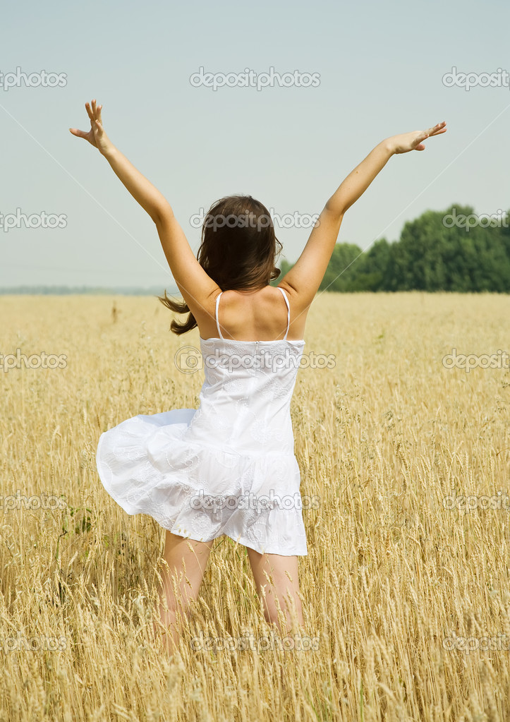 Standing girl  in white dress at cereals field in summer — Photo #3842078