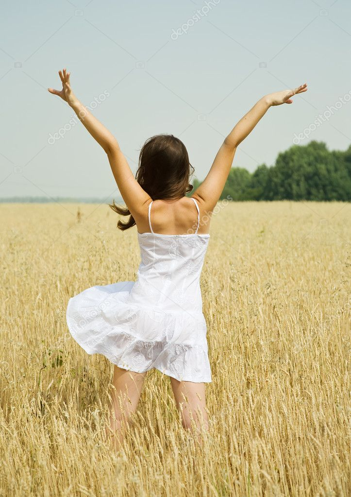 Standing girl  in white dress at cereals field in summer — Lizenzfreies Foto #3842078