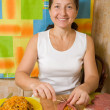 Royalty-Free Stock Photo: Woman sewing  stuffed beef by toothpicks