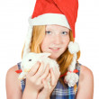 Teen  in santa hat with rabbit - Stock Photo