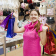 Woman with purchases in underwear shop — Stock Photo