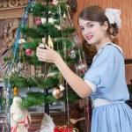 Girl decorating Christmas tree — Stock Photo #4098776