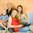 Royalty-Free Stock Photo: Family using  laptop at home
