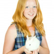 Girl with pet rabbit - Stock Photo