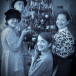 Retro photo of Family near Christmas tree — Stock Photo