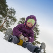 Child sliding in the snow — Stock Photo