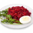 Salad from stewed beet and carrot - Stock Photo