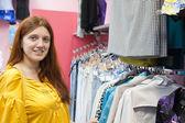 Woman at clothes shop — Stock Photo