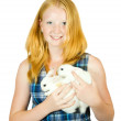 Teen girl with rabbit - Stock Photo