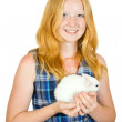 Stock Photo: Girl with pet rabbit