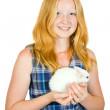 Girl with pet rabbit — Stock Photo
