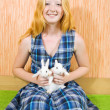 Teen  girl with   rabbits  indoor - Stock Photo