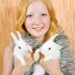 Girl two rabbits - Stock Photo