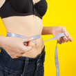 Girl measuring waist — Stock Photo