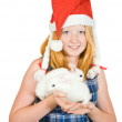 Stock Photo: Girl in santa hat with rabbits
