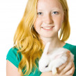 Stock Photo: Teen girl with rabbit