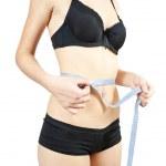 Girl measuring waist — Stock Photo #4101947