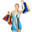 Stock Photo: Happy girl holding shopping bags