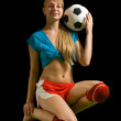 Female football player with ball — Stock Photo #4102015