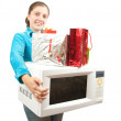 Girl with mini oven and presents over white — Stock Photo #4102119