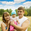 Father and mother with baby — Stock Photo #4102652