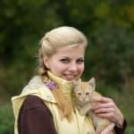 Portrait of girl with kitten — Stock Photo