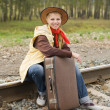 Pretty girl sitting on rail — Stock Photo