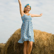 Stock Photo: Girl standing on hay