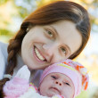 Happy mother with her baby — Stock Photo #4109600
