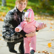 Mother with baby against autumn — Stock Photo