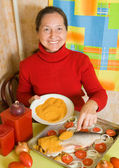 Woman is making breaded fish — Stock Photo