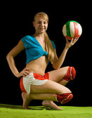 Sporty girl posing with volley-ball — Stock Photo