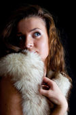 Woman covered with a polar fox fur — Stock Photo
