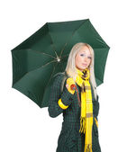 Girl in green coat with umbrella — Stock Photo