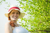 Girl in hat near birch — Stock Photo