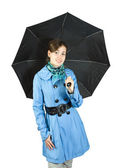 Woman in raincoat with umbrella — Stock Photo