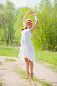 Pregnant woman on summer road — Stock Photo