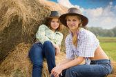 Farm girls at field — Stock Photo