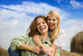 Happy girls at field — Stock Photo