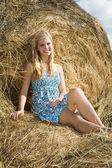 Girl resting on hay — Stock Photo