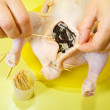 Cook sewing stuffed chicken — Stock Photo