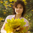 Stock Photo: Of girl with autumn bouquet