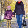 Mother with her girl in autumn park — Stock Photo