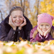 Mother with her girl in autumn - Stock Photo