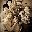 Retro  photo of Family decorating Christmas tree — Stock Photo